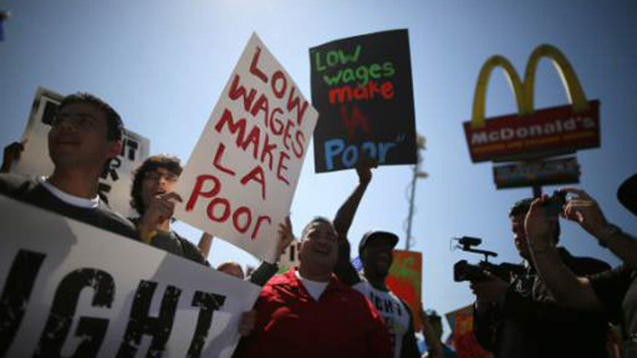 Former McDonald's USA CEO Ed Rensi on the fast food chain unveiling its 'biggest Big Mac ever' and the impact of minimum wage hikes on the economy.