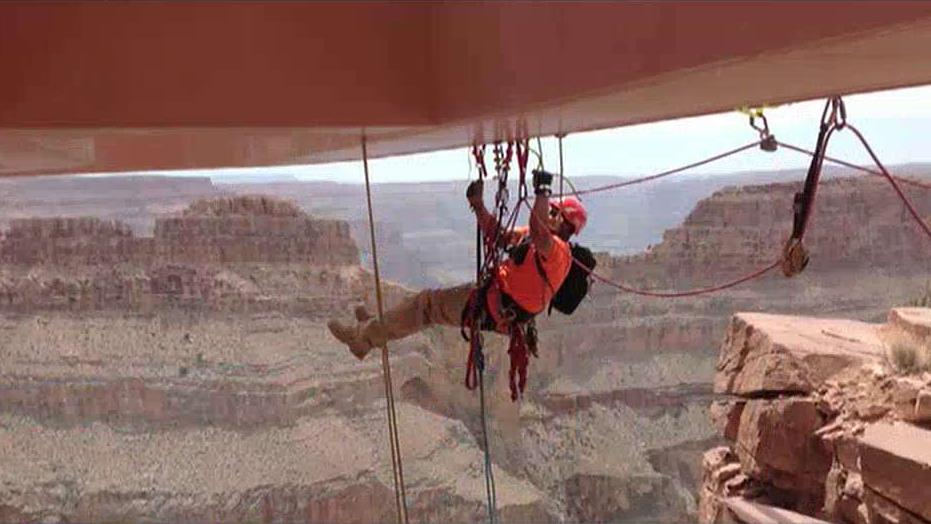 Abseilon USA CEO Kenneth Piposar and Abseilon USA Rope Access Technician Casey Gilmore on the challenging job of cleaning the Skywalk, thousands of feet above the Grand Canyon in Arizona.