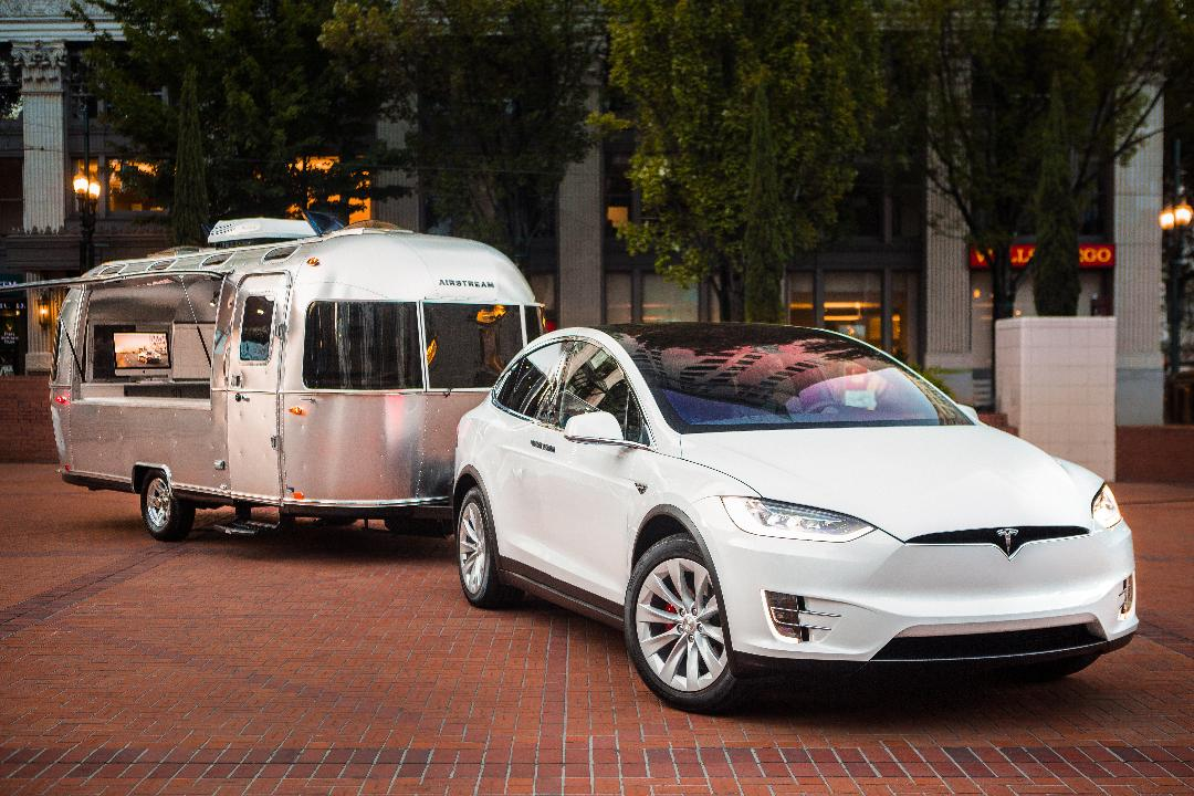Sit, shop and design your very own Tesla in the company's mobile dealership, currently touring across America.