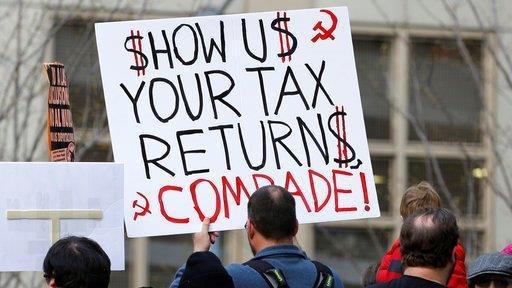 Trump fires back at anti-Trump tax march