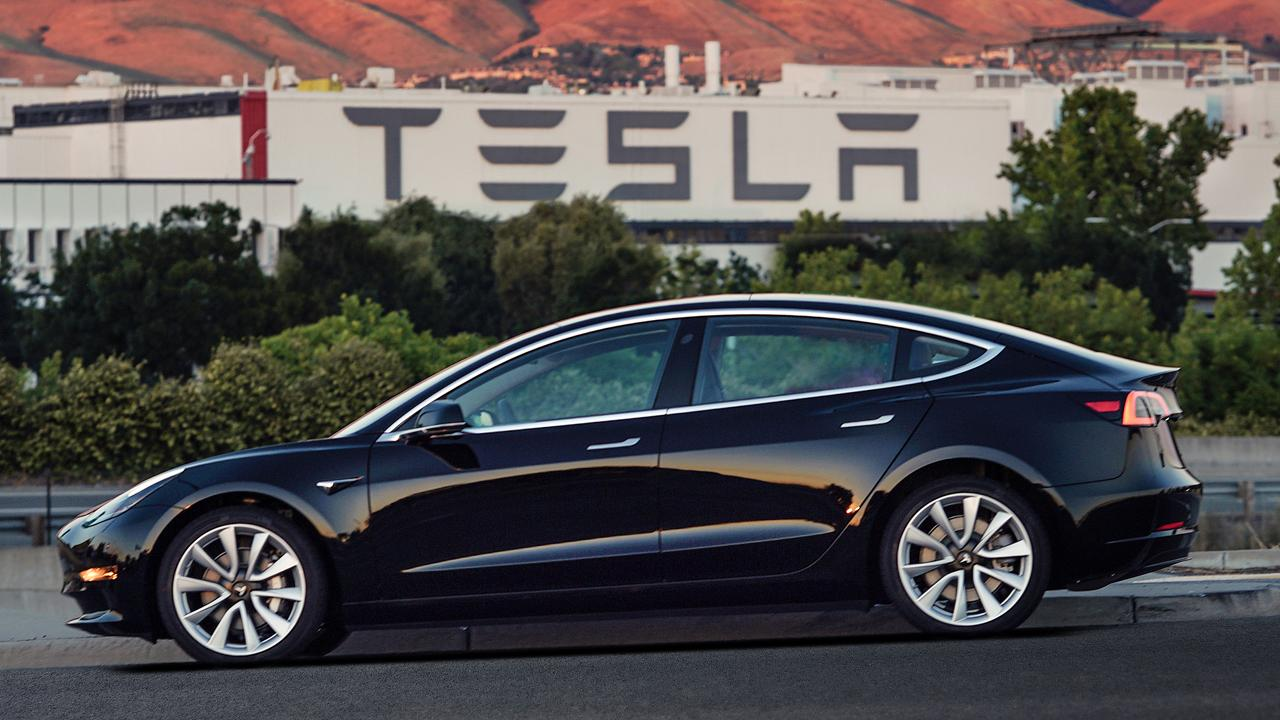 Tesla rolls out the Model 3 with prices starting at $35,000