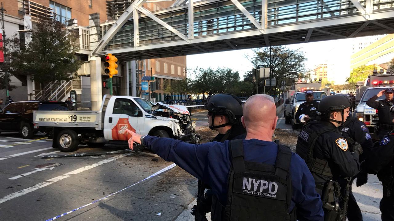 Rep. Chris Collins (R-N.Y.) reacts to a vehicle plowing into bicyclists and pedestrians in Lower Manhattan.