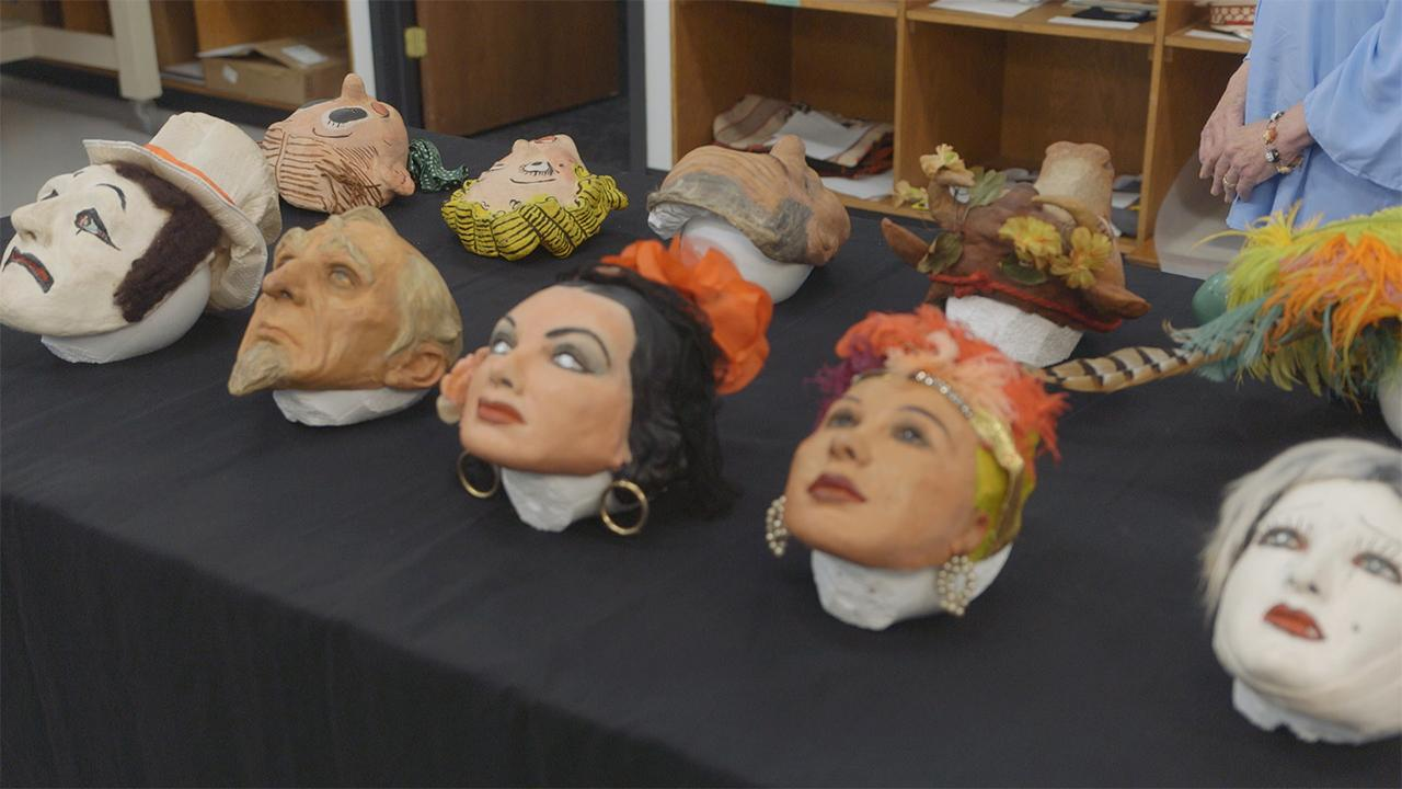 An artist's daughter inherits hundreds of priceless hand-made masks of famous figures from the 1930s and 40s.
