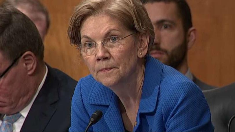 Sen. Elizabeth Warren, (D-Mass.), questions Federal Reserve Chair Jerome Powell.