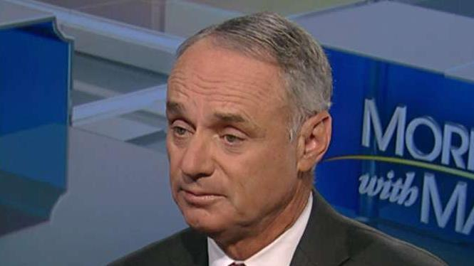 MLB Commissioner Rob Manfred discusses the unintended consequences of the new tax law.