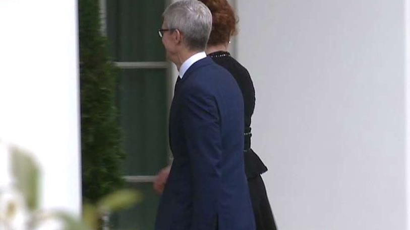 Apple CEO Tim Cook arrives at the White House for a meeting with President Trump.