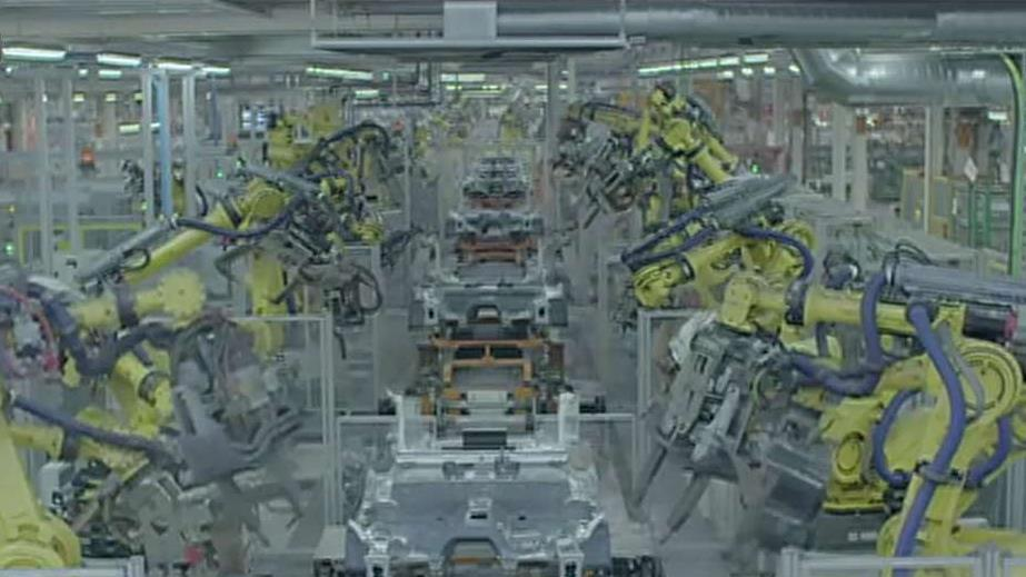FBN's Charles Payne on Spanish automaker SEAT showing off how the robots in its factory work together to build cars.