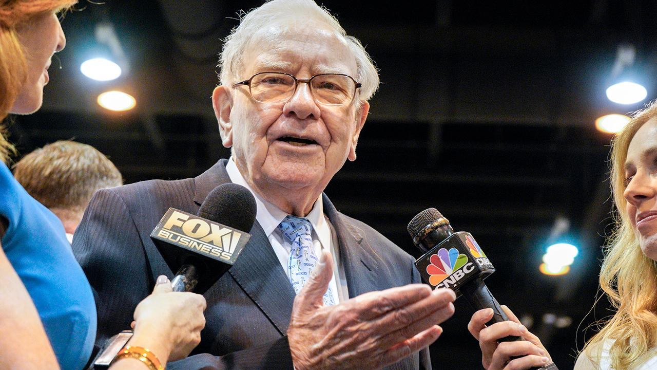 Billionaire Warren Buffett discusses the record-breaking attendance at the Berkshire Hathaway annual meeting and why he isn't pulling the plug on Wells Fargo.