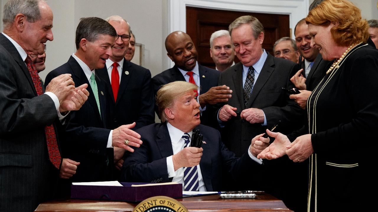 President Trump on the new bill easing Dodd-Frank banking regulations.