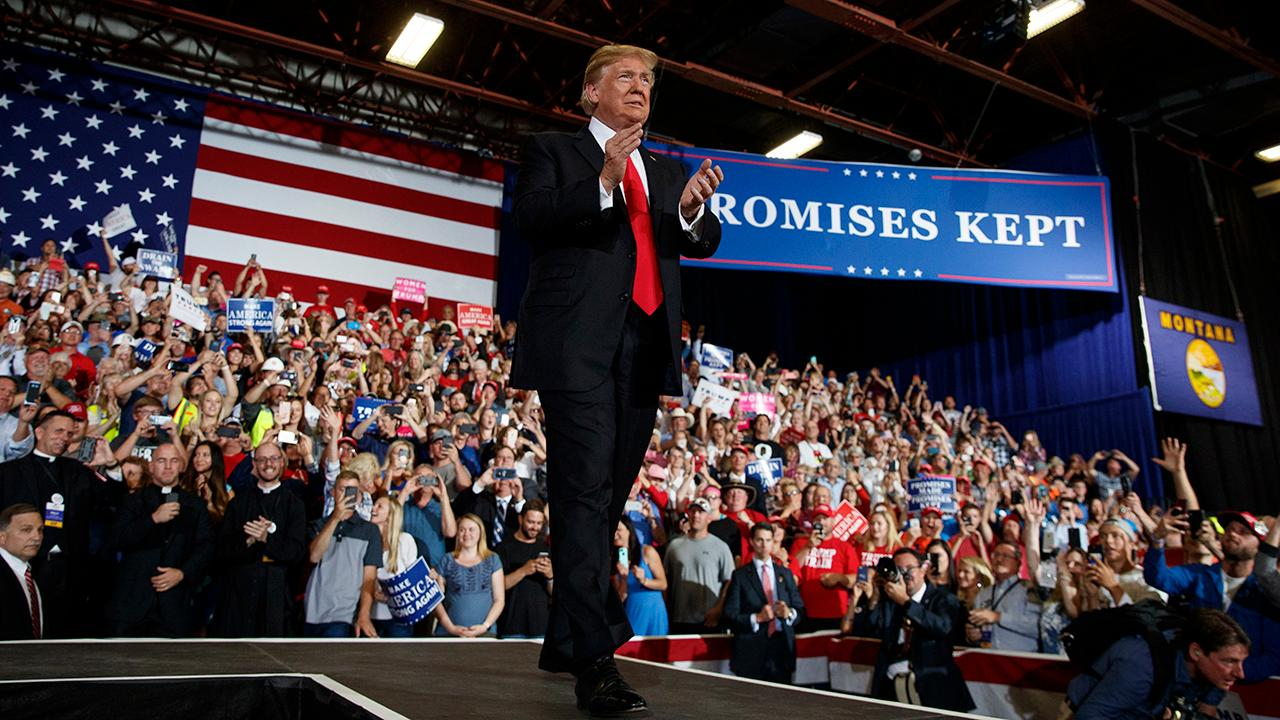 President Trump touts U.S. economic growth while addressing supporters at a Make America Great Again rally in Great Falls, Montana.