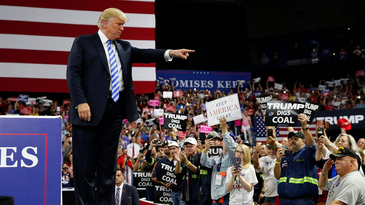 President Donald Trump touts U.S. job growth during a Make America Great Again Rally in Charleston, West Virginia.