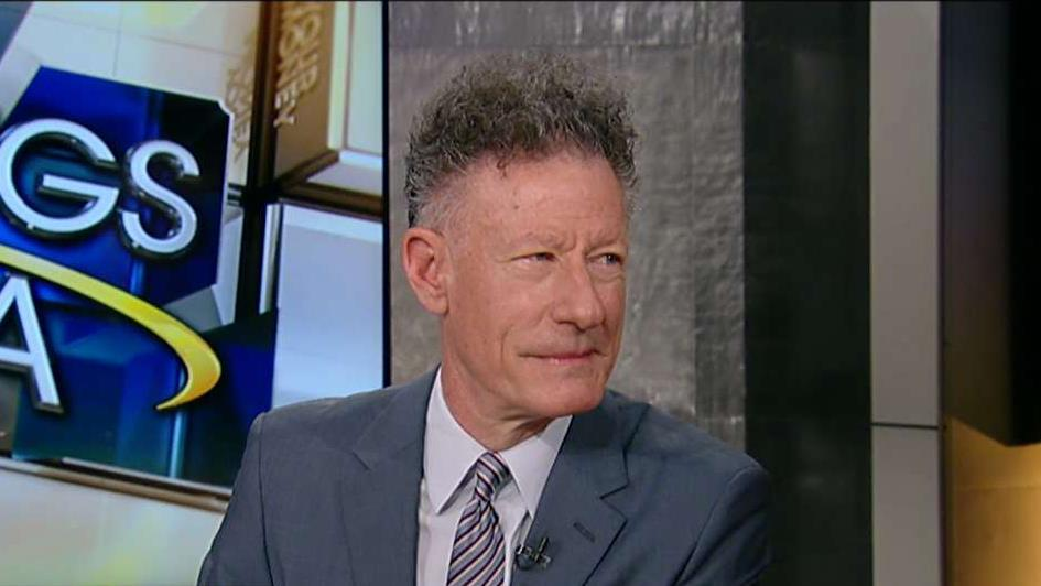 Country music singer Lyle Lovett on his band, all five living U.S. presidents attending the benefit concert last year for Hurricane Harvey relief and the changes in the music business.