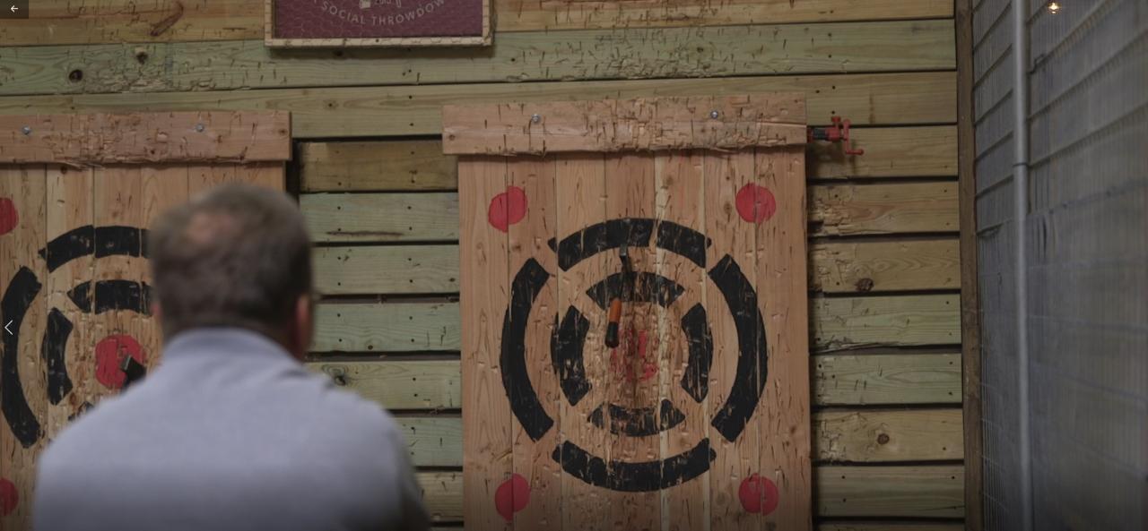Stuart Josberger, co-owner of Stumpy's Hatchet House, demonstrates how to throw a hatchet.