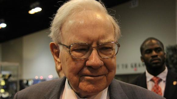 Berkshire Hathaway CEO Warren Buffett discusses how he isn't giving up on Wells Fargo and why it would be a poor idea for Apple to invest in Tesla.
