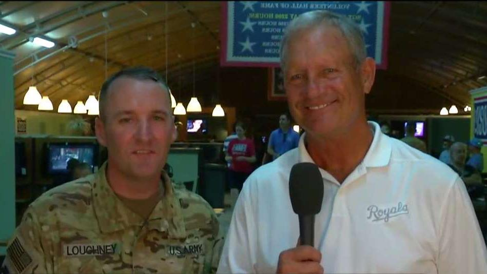 Major League Baseball Hall of Famer George Brett and Lt. Col. Todd Loughney of the Missouri National Guard on K.C. Royals legends joining troops in the Middle East to watch the K.C. Royals 9/11 game.