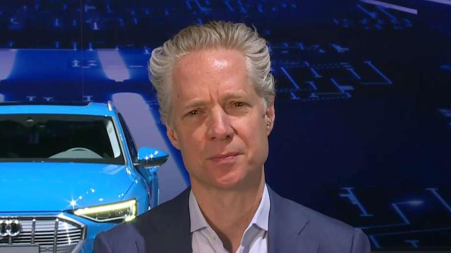 Audi of America President Scott Keogh discusses how the car company introduced its first electric SUV, the e-tron and their partnership with Amazon.