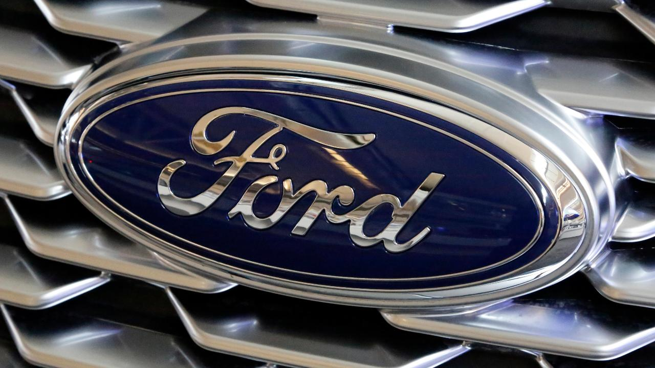 FBN's Cheryl Casone on Ford's decision to not build its Focus Active in the U.S. and the automaker teasing about a new all-electric vehicle.