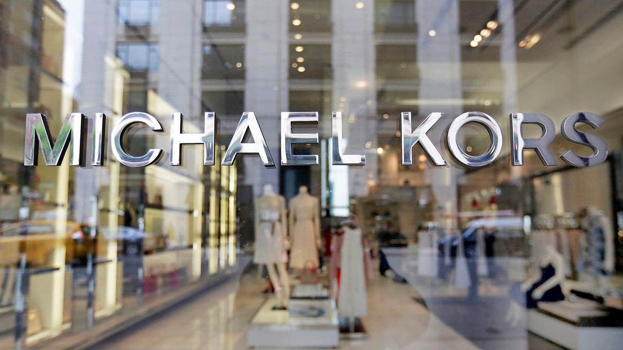 Michael Kors said that it would buy Versace for $2.1 billion.