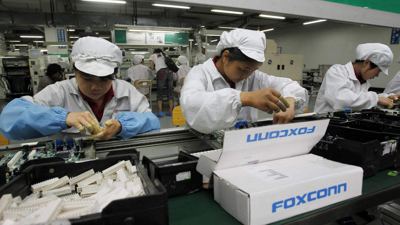 Foxconn defends Wisconsin plans as job creation pledge questioned