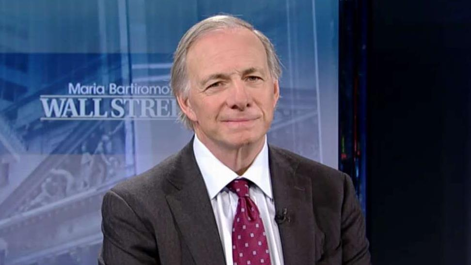 Bridgewater Associates founder Ray Dalio says that the Federal Reserve won't consistently raise interest rates next year.