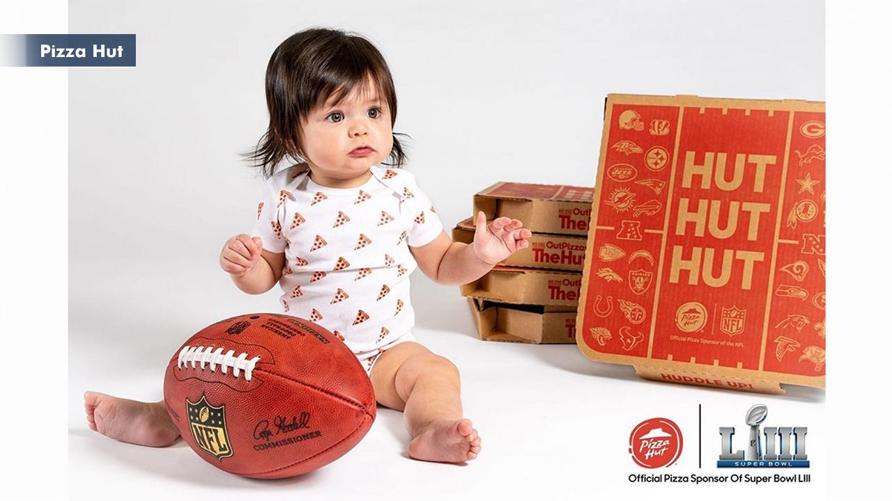 Morning Business Outlook: Pizza Hut, the official pizza sponsor of the NFL, will be giving away free pizza and tickets to next year's Super Bowl to the family of the first born baby after kickoff through an online contest; Facebook is shutting down a controversial spying app for iOS.