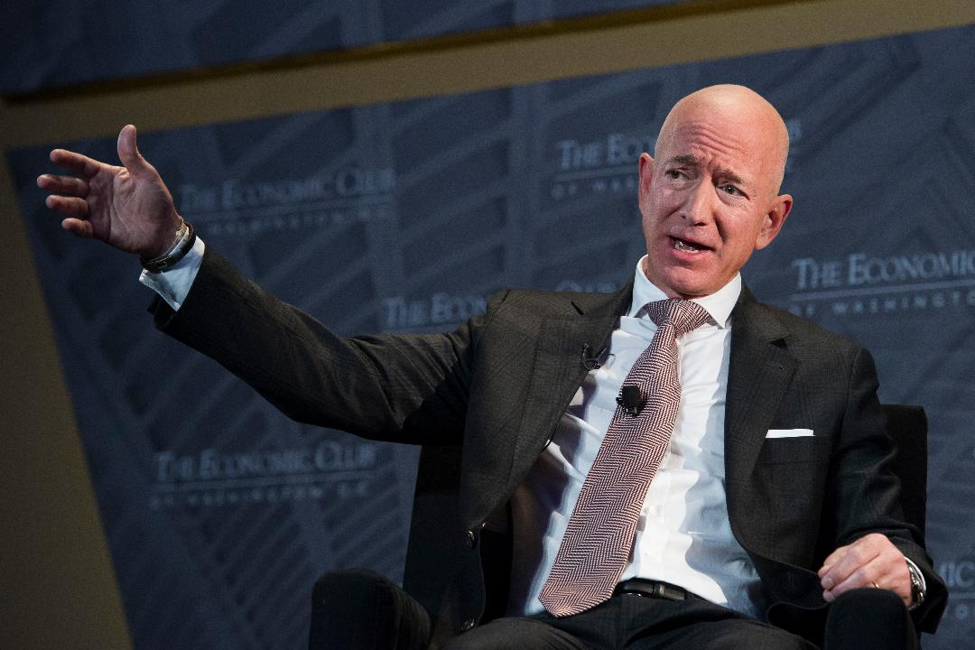 "Amazon CEO Jeff Bezos accused the owner of the National Enquirer of ""extortion and blackmail"" over leaked naked photos."