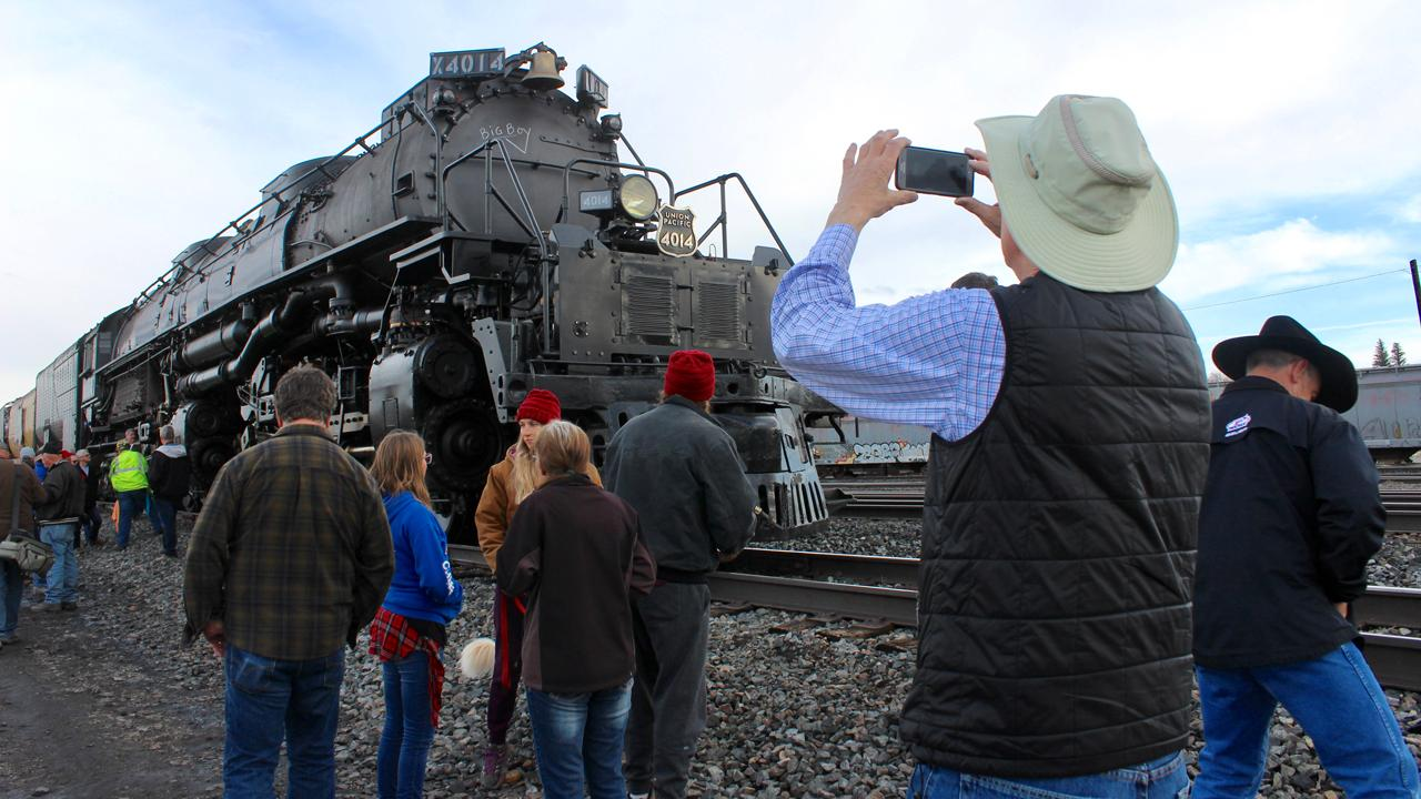 A Big Boy locomotive rolled out of a Union Pacific restoration facility, returning to the rails in Wyoming after five years of refurbishment. The train headed toward Utah as part of a tour commemorating the 150th anniversary of the Transcontinental Railroad.