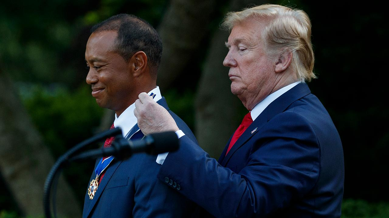 President Trump presents Tiger Woods with the Presidential Medal of Freedom.