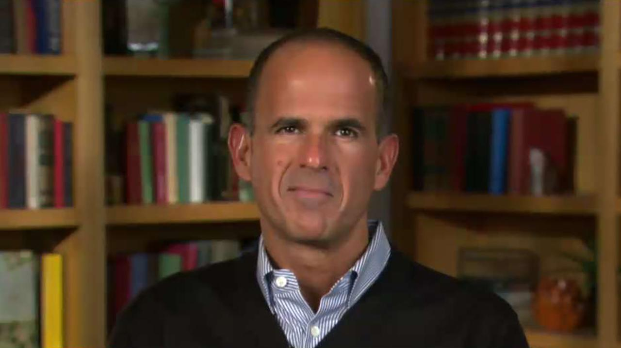Marcus Lemonis, chairman and CEO of Camping World, says that he won't take down the large American flag flying above his store, despite a North Carolina city's lawsuit demanding that he do so.