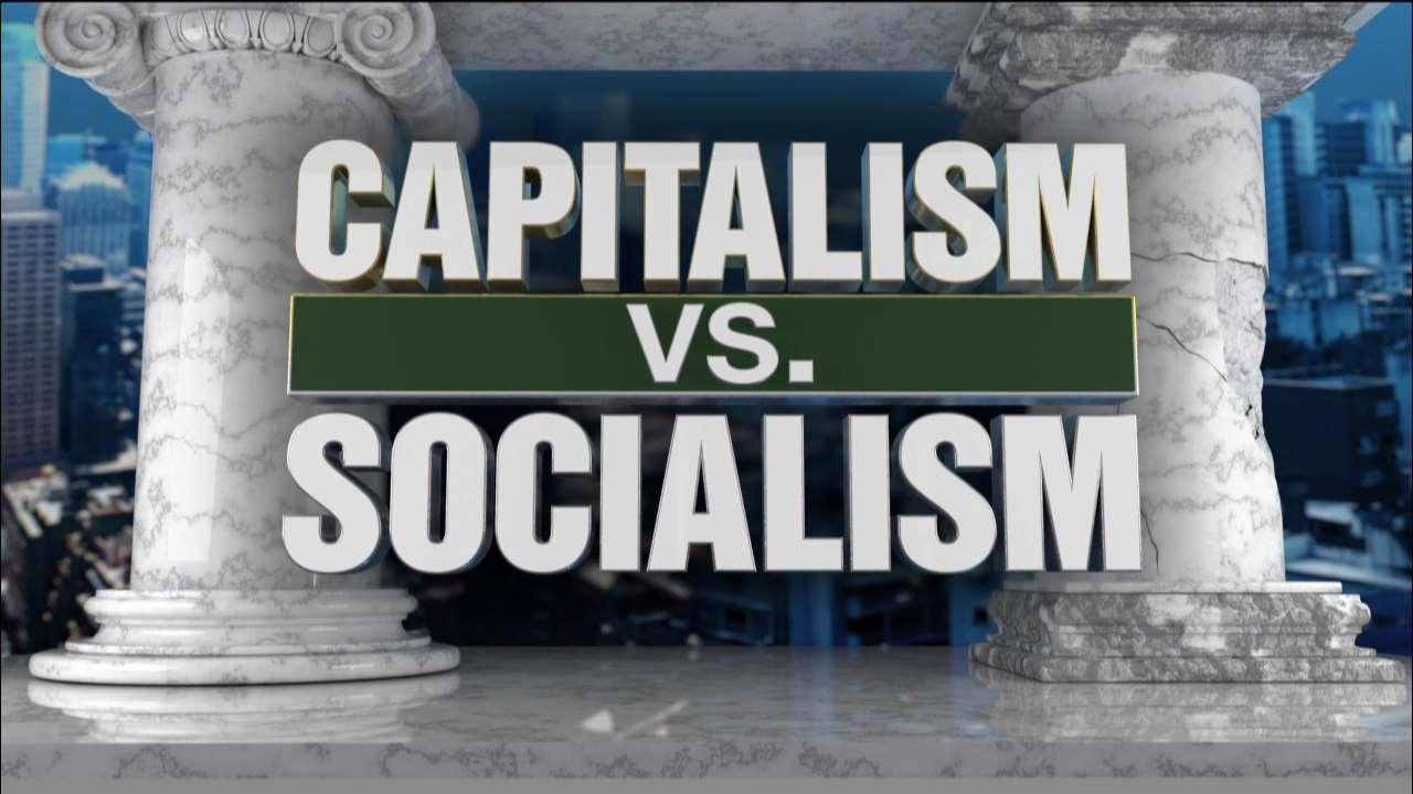 "FOX Business' Stuart Varney, The New Voice CEO Herman Cain, Bianca Cunningham of NYC Democratic Socialists of America, ""Capitalism's Crisis Deepens"" author Richard Wolff answer questions from a live studio audience about capitalist and socialist policies."