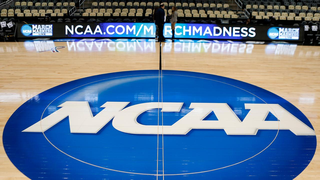 The NCAA threatened to bar California universities from championship games if lawmakers pass a bill allowing student-athletes to profit from their image and likeness.
