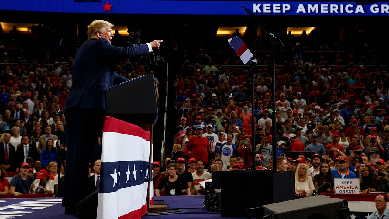 President Trump talks about the U.S.-China trade war during a rally in Orlando, Florida.
