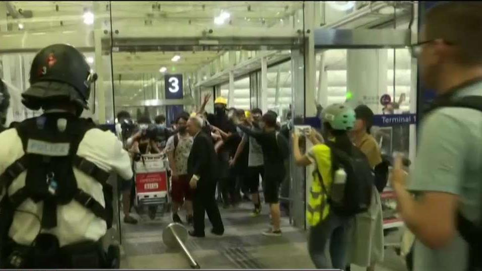 Thousands of protesters swarmed the Hong Kong airport for a second day.