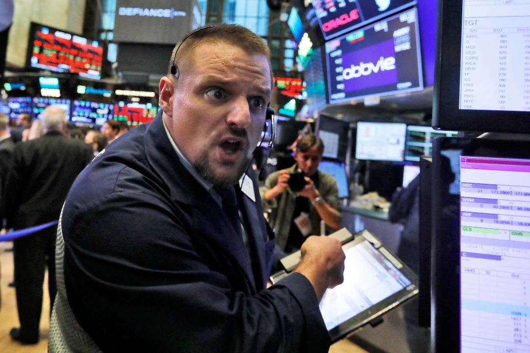 Stocks are turning lower as bond yields slide again.