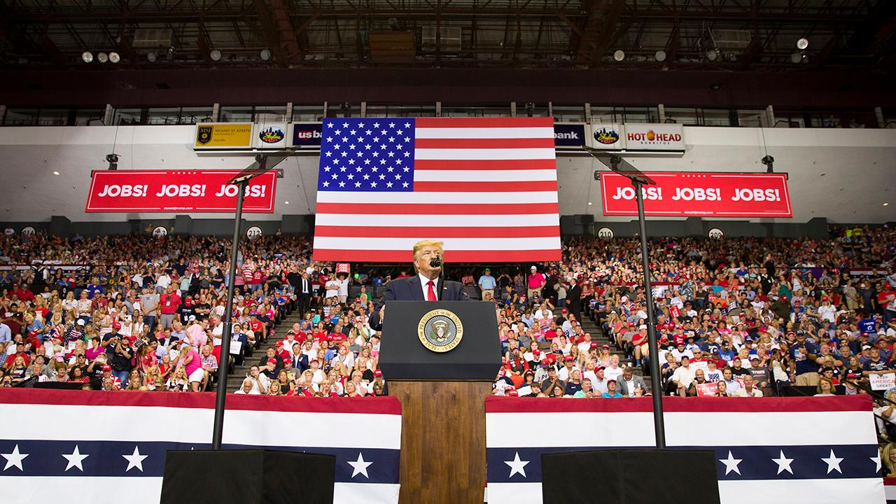 President Trump talks about his new China tariff during a rally in Cincinnati, Ohio.