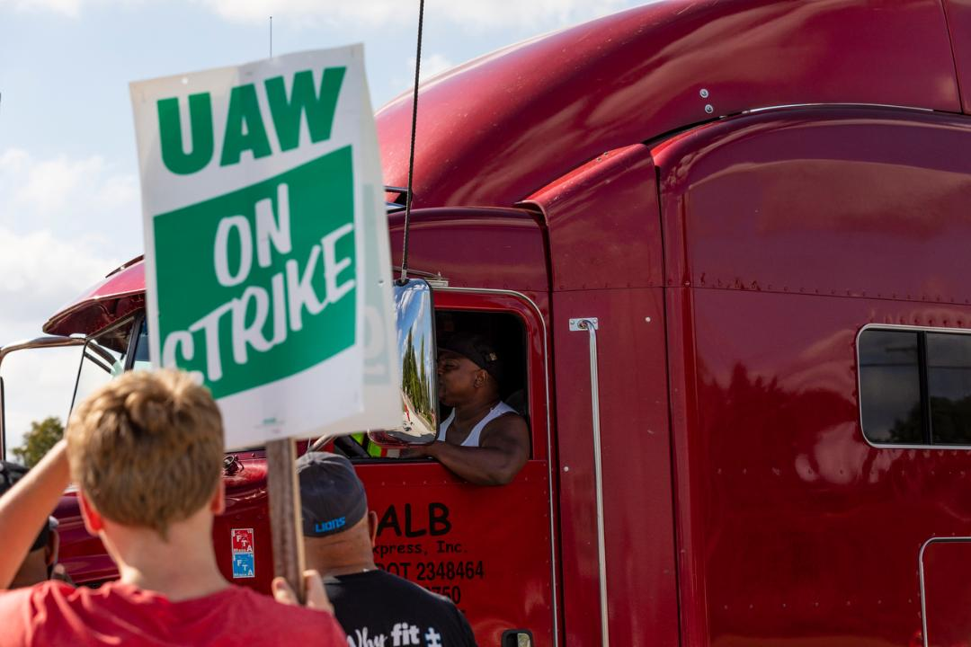 Grady Trimble reports in from day three of the GM UAW strike in Detroit after strikers' health benefits were dropped.