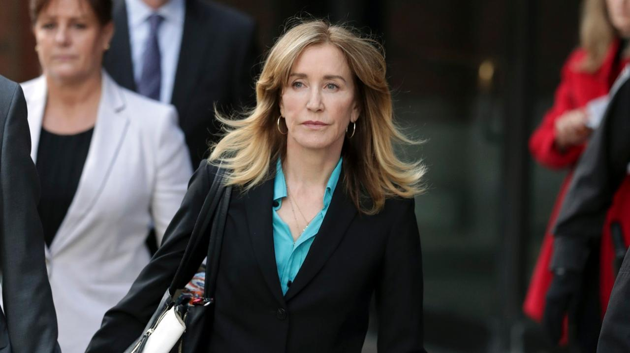 Felicity Huffman is sentenced to 14 days in prison in the college cheating scandal.