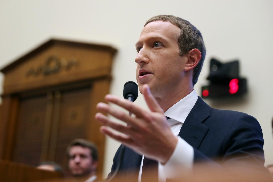 CEO Mark Zuckerberg says when content is flagged by users or Facebook software it can be placed into a queue for review.