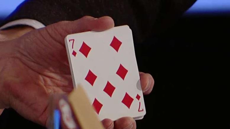 Mentalist Oz Pearlman displays his psychic skills on set with FOX Business' Stuart Varney, Susan Li and Deirdre Bolton.