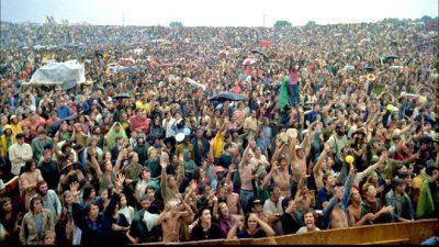 Woodstock festival co-creator Michael Lang argues climate change is a larger issue than the Vietnam War.