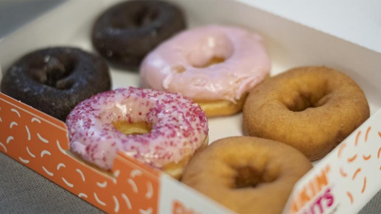 Morning Business Outlook: Dunkin' offering active duty military a free doughnut of their choice for Veterans Day; WalletHub survey shows 33 million Americans say they don't have money for a winter vacation and NerdWallet says millennials are worrying over credit card and student debt.