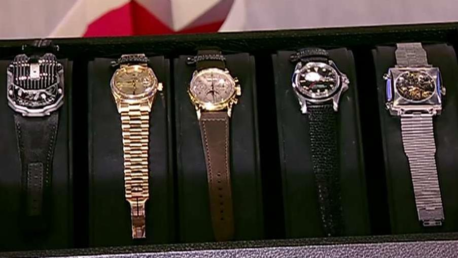 Phillips Americas head of watches Paul Boutros displays cinematic watches on the auction block  for charity including Marlon Brando's 'Apocalypse Now' Rolex.