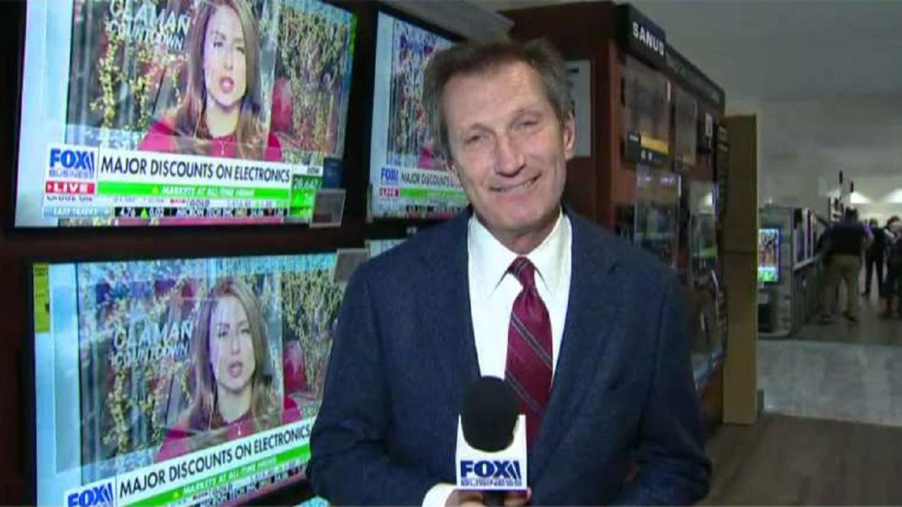 FOX Business' Jeff Flock and Abt Electronics' Carl Prouty discuss why tech products like TVs and video game consoles are on sale today. Prouty says retailers often over order products and then discount them to make room for the new year's gadgets.