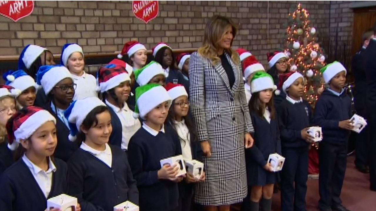 First Lady Melania Trump pays a visit to Salvation Army Centre in Clapton, East London, to meet local children and prepare holiday gifts for less fortunate community members.
