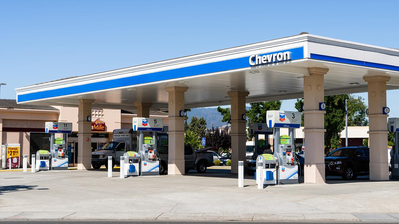 Chevron is writing down the value of some of its assets due to oversupply.