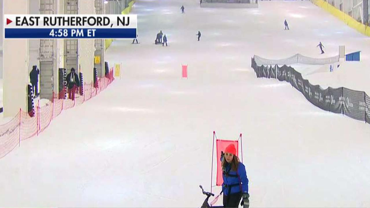 FOX Business' Kristina Partsinevelos is live from New Jersey to report on the first real-snow, year-round, indoor ski park opening in the U.S. and tired out a 'ski bike.'