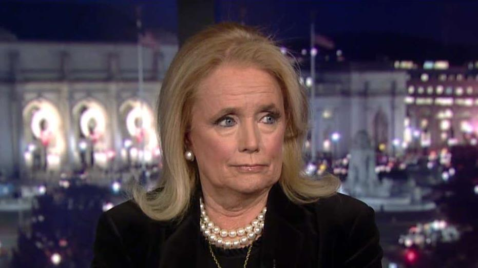 Rep. Debbie Dingell, a Michigan Democrat, responds to President Trump's comments about her late husband during his Battle Creek, Michigan, speech.