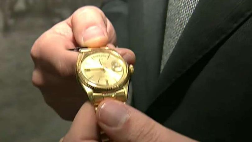 FOX Business' Lauren Simonetti shows viewers Marlon Brando's Rolex watch that is expected to sell for more than $1 million at a luxury watch auction. Phillips Americas' Head of Watches, Paul Boutros, later shows Simonetti pro-golfer Jack Nicklaus' Rolex he donated to the event.