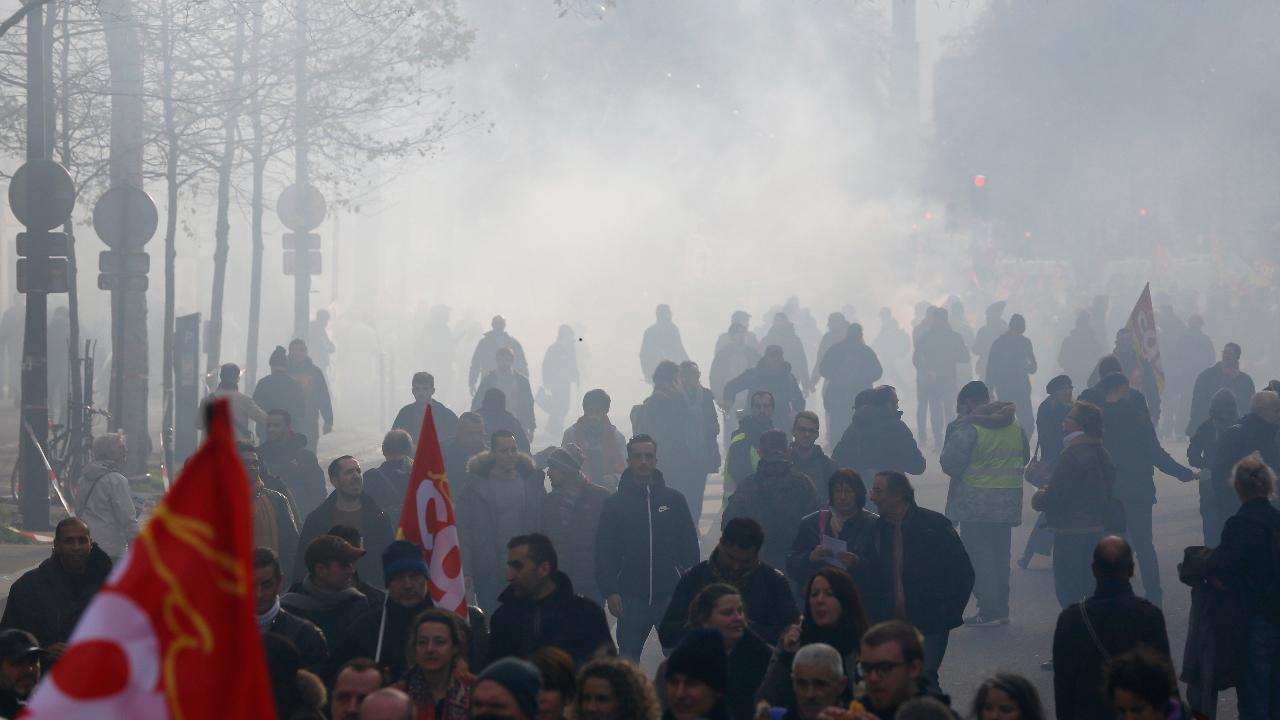 Angry over President Macro's pension overhaul plans, thousands of French take to the streets
