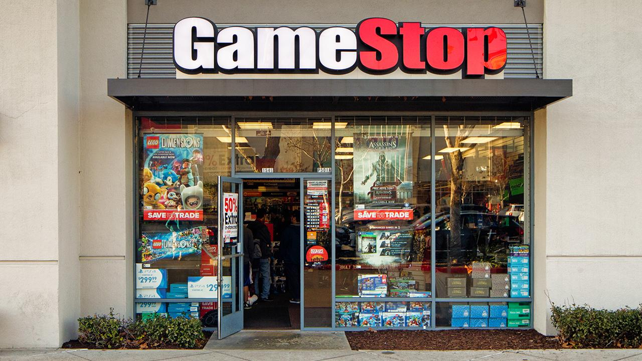 Gamestop stock plummets due to weak holiday and in-store sales, struggling to stay afloat in a digital universe.